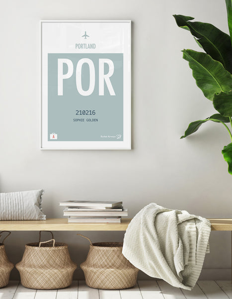 Lifestyle image of a hallway with wooden bench seat and seagrass baskets with a print on the wall depicting Portland in teal