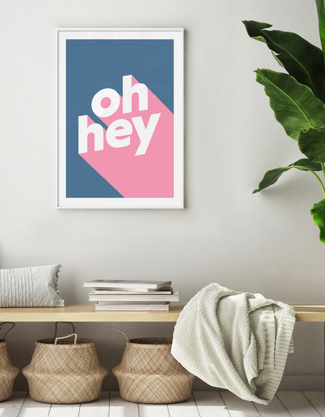 modern typography print with the words oh hey in lowercase type in white on pink against a blue background
