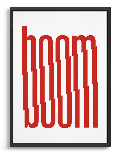 framed typography art print of the word boom in red text against a white background
