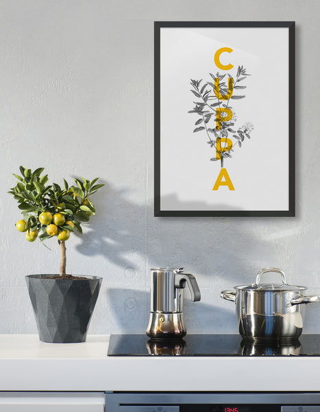 Cuppa typography print - features the text Cuppa in yellow overlaid onto a line drawing of a tea plant