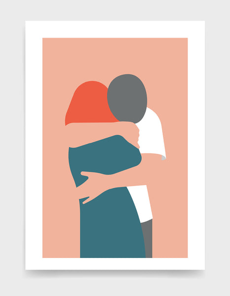 Couple hugging against a pink background. The girl is facing away and has red hair and a blue dress whilst the man is leaning over her shoulder arms around her wearing a white tshirt