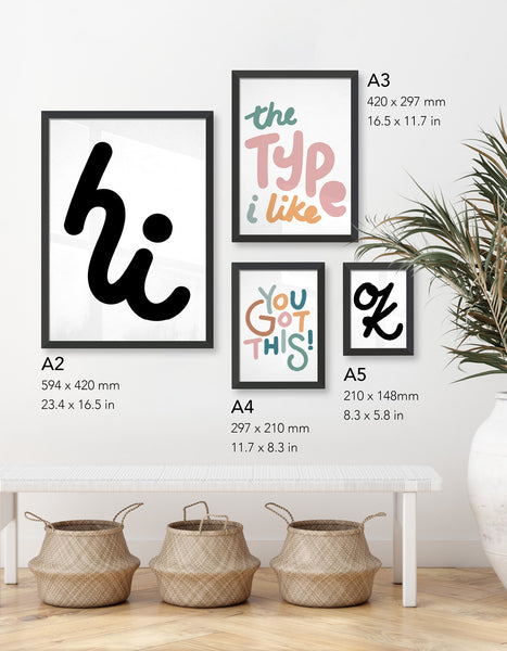 Example gallery wall image showcasing typography prints in varying sizes