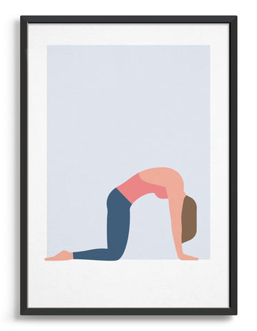 black framed art print of a woman in cat cow yoga pose on a blue background
