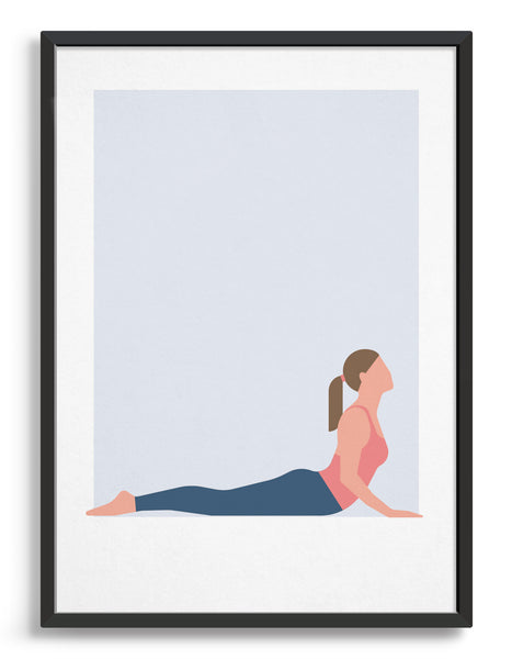 framed art print of a woman in cobra yoga pose against a pale grey background