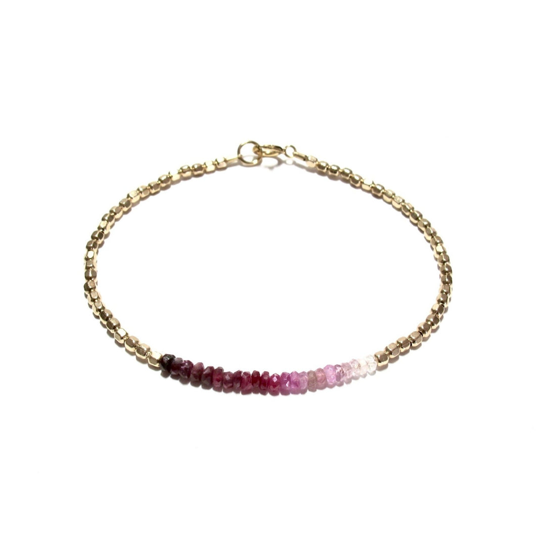 shaded ruby line and gold beads bracelet