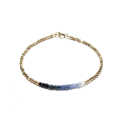 shaded sapphires line and gold beads bracelet