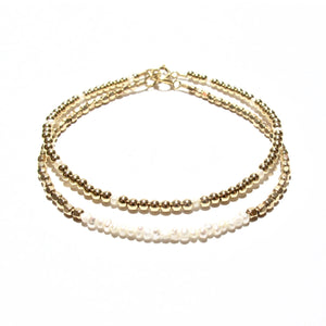 pearl line and golds beads bracelet