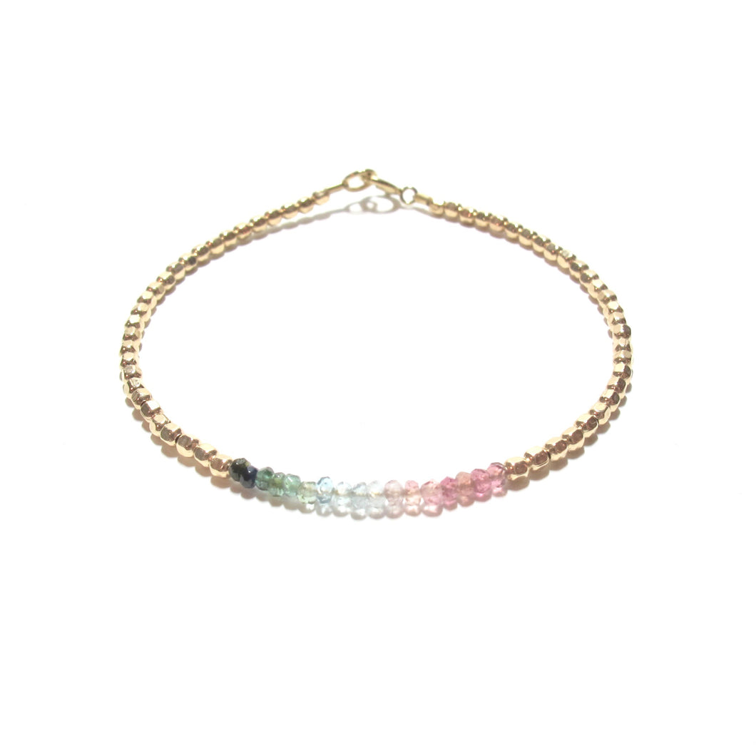 rainbow tourmaline line and gold beads bracelet