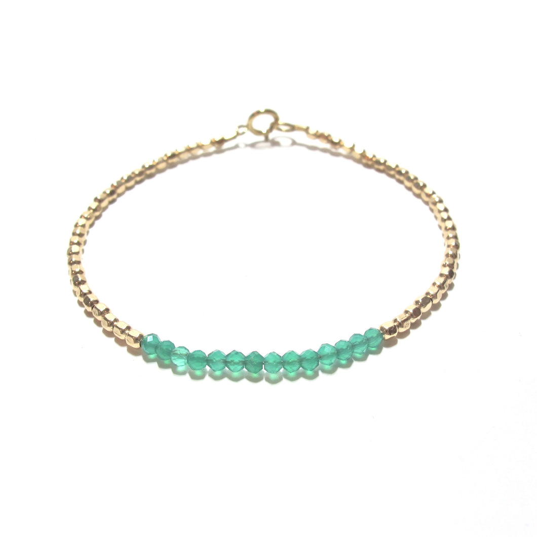 green onyx line and gold beads bracelet