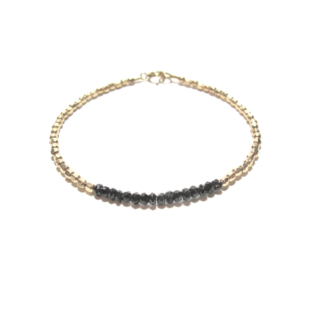 black spinel line and gold beads bracelet