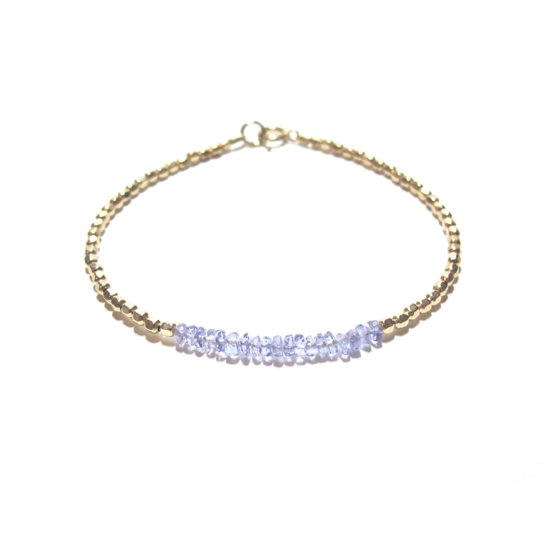 tanzanite line and gold beads bracelet