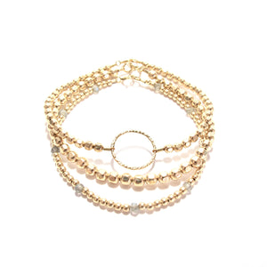 gold beads and ring bracelet