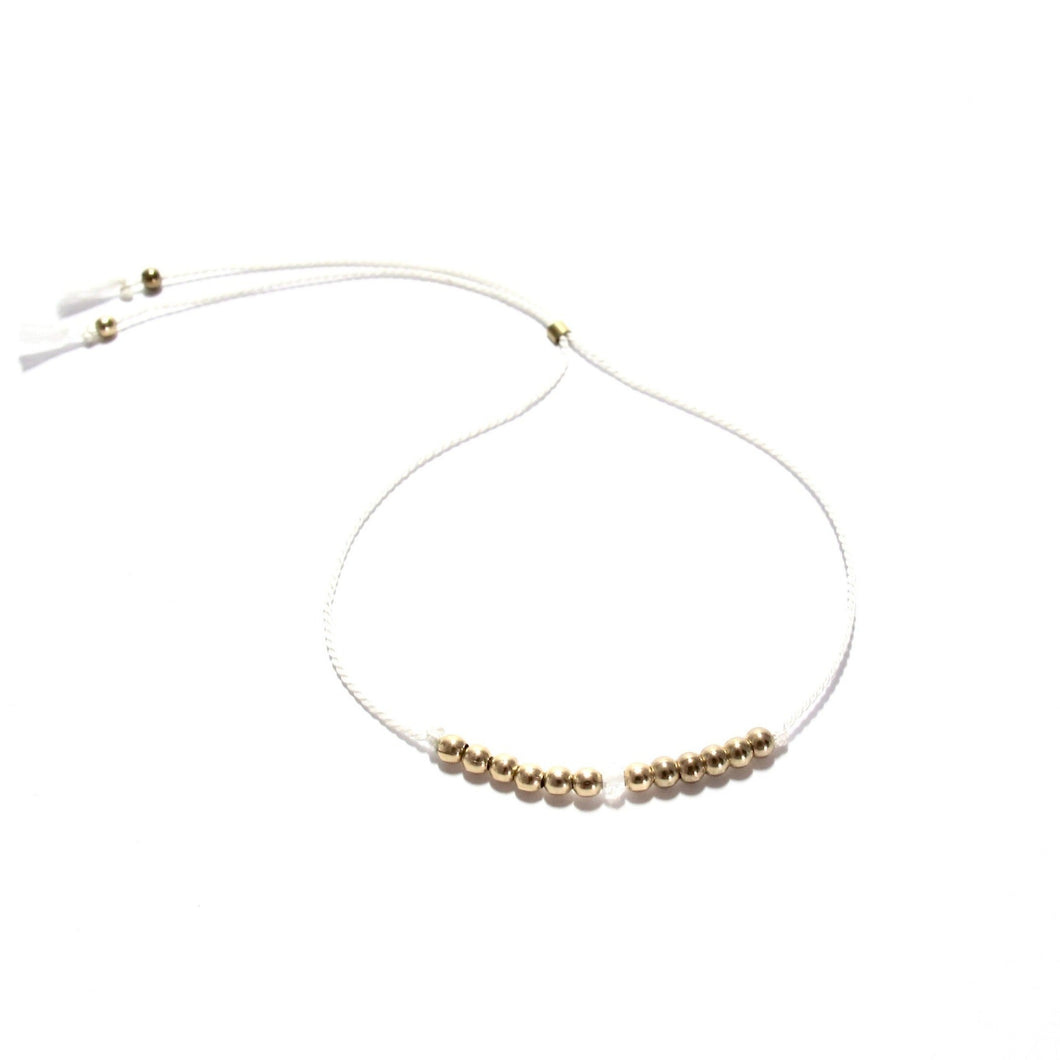 white silk friendship braceet