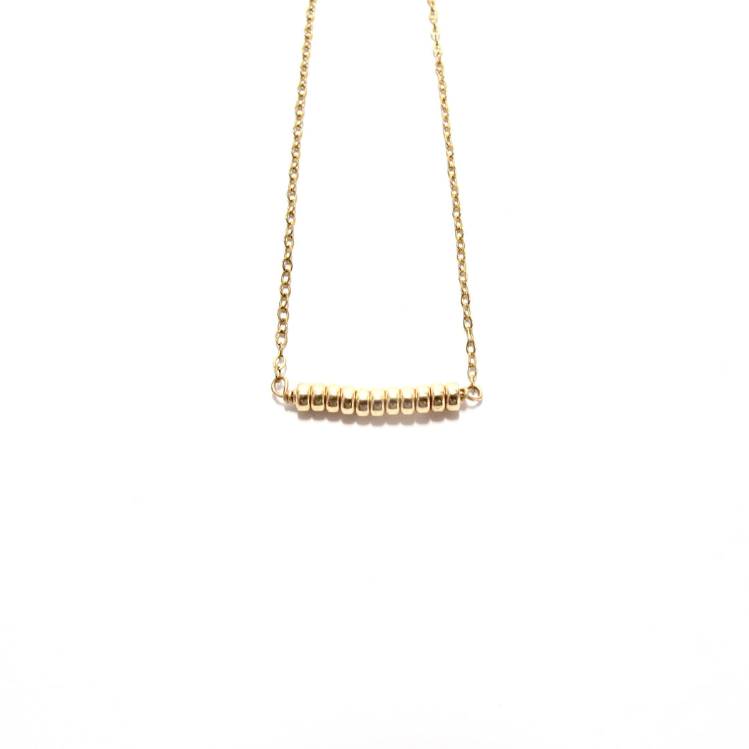 gold rondelles line necklace