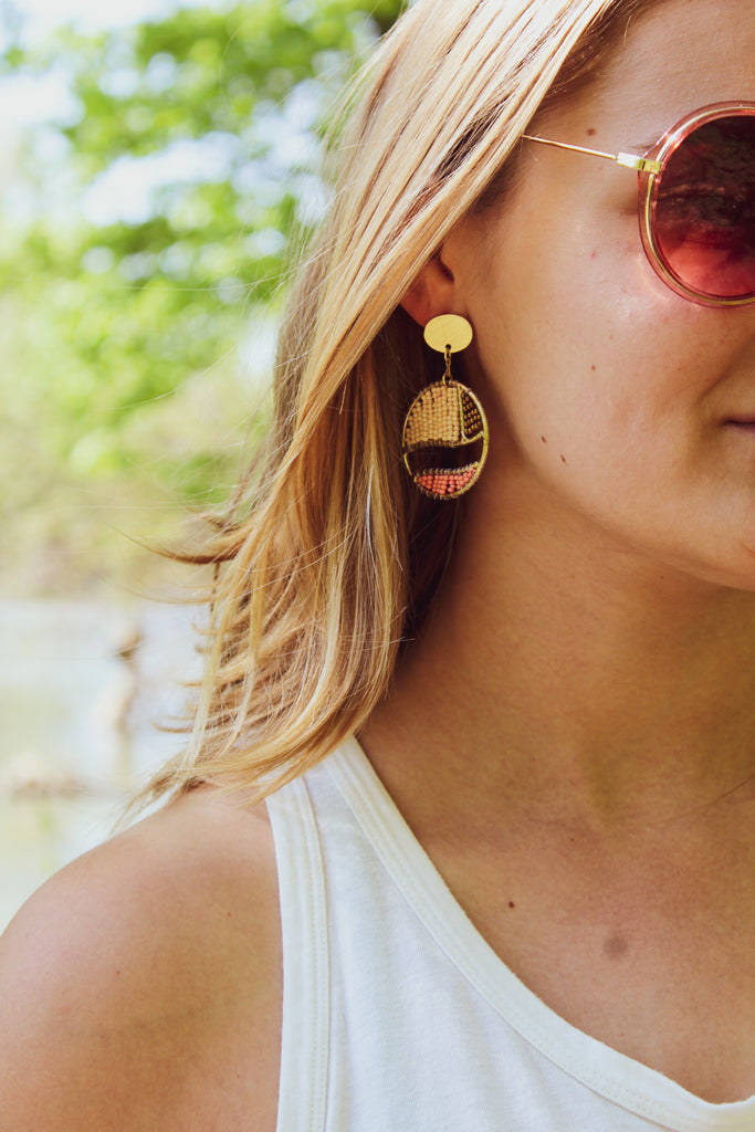 Blond Girl in Beaded Fair Trade Earrings and Big sunglasses