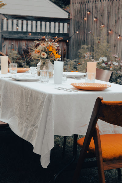 Backyard Garden dinner party, anice table setting next to wildflowers