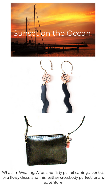 Picture of sunset with sail boats, pink and black long wavy earrings, black leather crossbody bag with pink purse charm