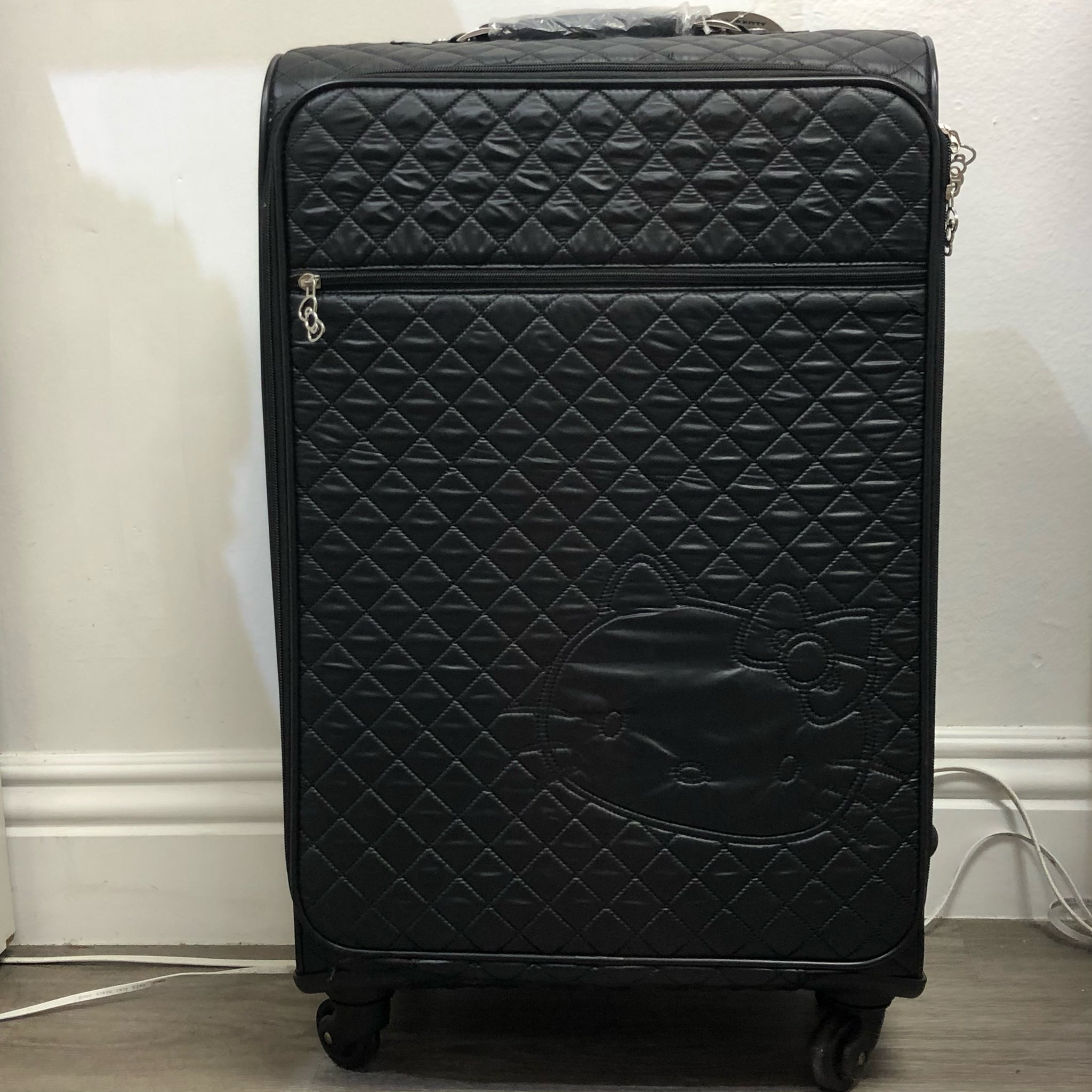 Hello Kitty Black Quilted Rolling Suitcase