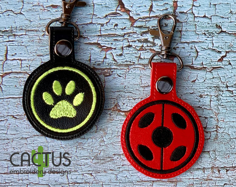 Miraculous: Ladybug & Cat Noir Snap Tabs Set of 2 Machine Embroidery Designs