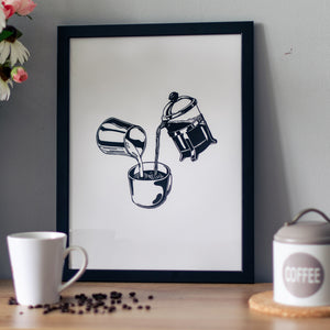 Framed poster of a French press and a can of milk