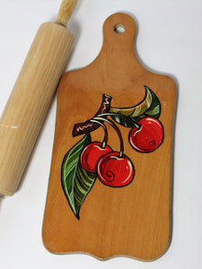 Cutting board with cherries