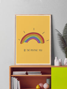 Be The Positive You Quote Print in a frame on a shelf