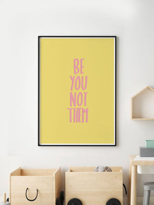 Be You Not Them Wall Print in a frame on a wall