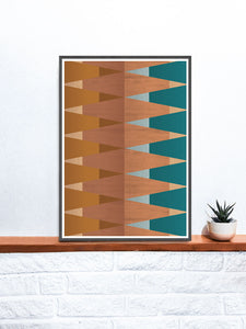 Copper Tops geometric wall art on a shelf