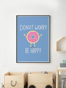 Donut Worry Be Happy Quirky Print in a frame on a wall
