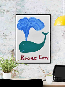 Kindness Cares Quirky Art Print in a frame on a wall