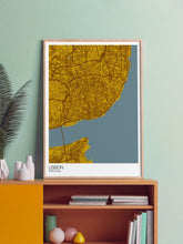 Load image into Gallery viewer, Lisbon City Map Wall Art in a frame on a shelf