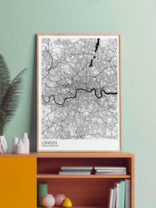 London City Map Drawing Print in a frame on a shelf