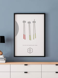 One Chopstick Sushi Art Print in a frame on a wall