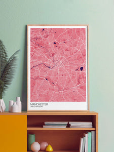 Manchester City Map Print in a frame on a shelf