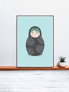 Matryoshka Monstera Russian Doll Art Print in a frame on a shelf