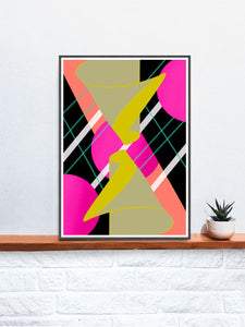 Mirrored Hugs Abstract Wall Art in a frame on a shelf