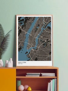 New York Graphic Map Design Print in a frame on a shelf