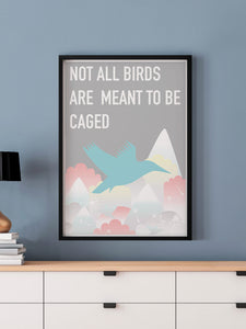 Caged Bird Art Print in a frame on a blue wall