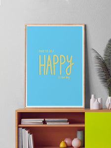 Happy Is Key Quirky Art Print in a frame on a shelf