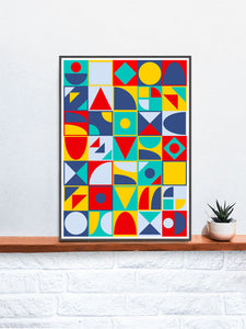 Pop Tones Shapes Abstract Art Print in a frame on a shelf
