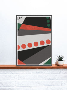 Red and Green Geometric Modern Wall Art in a frame on a shelf