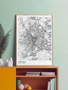 Sheffield City Art Design Print in a frame on a shelf