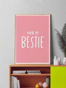 Bestie Typography Art Print in a frame on a shelf