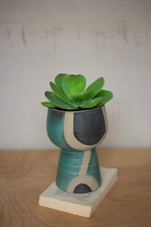 Small Black tan and turquoise ceramic vase