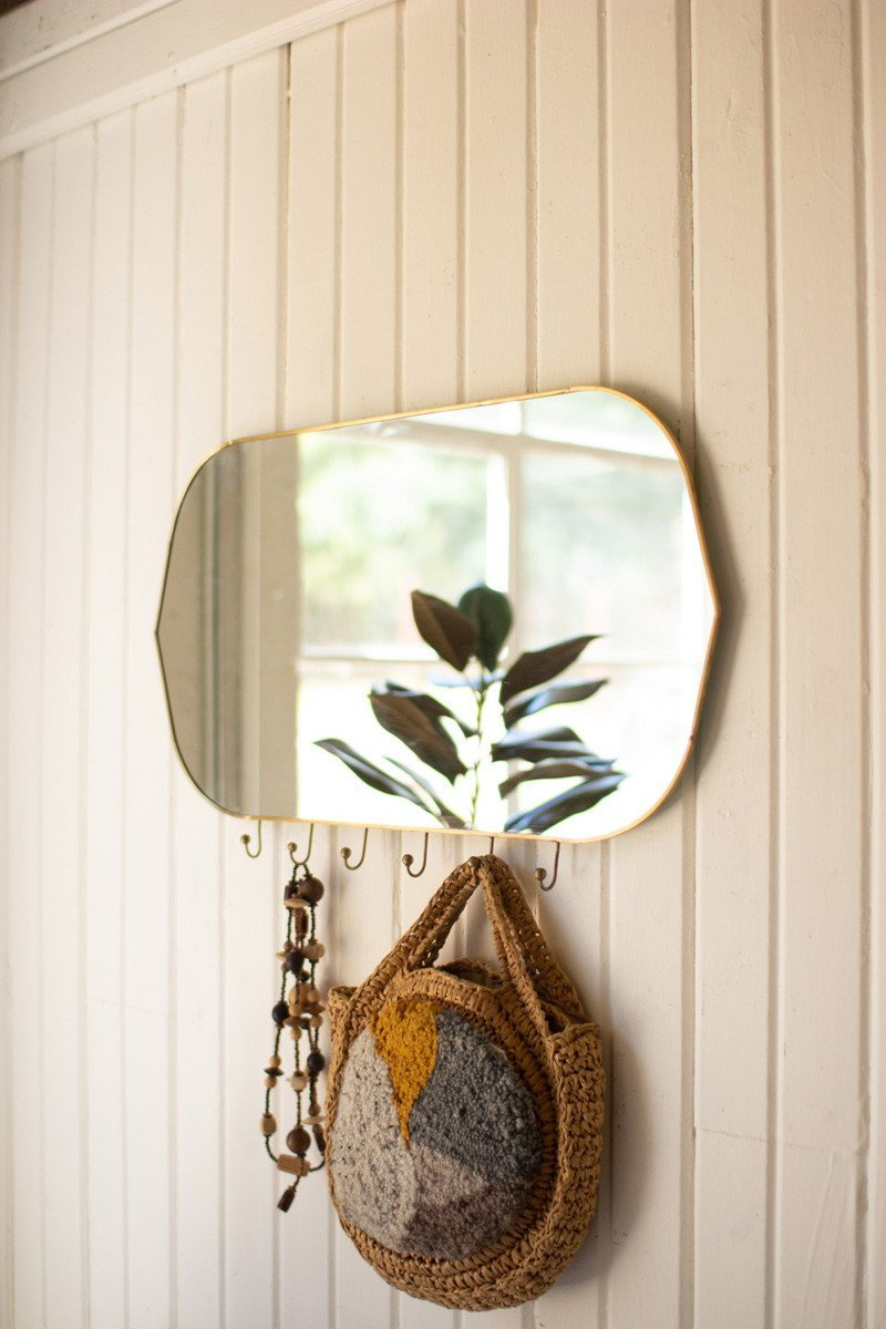 horizontal oval brass framed mirror with six hooks