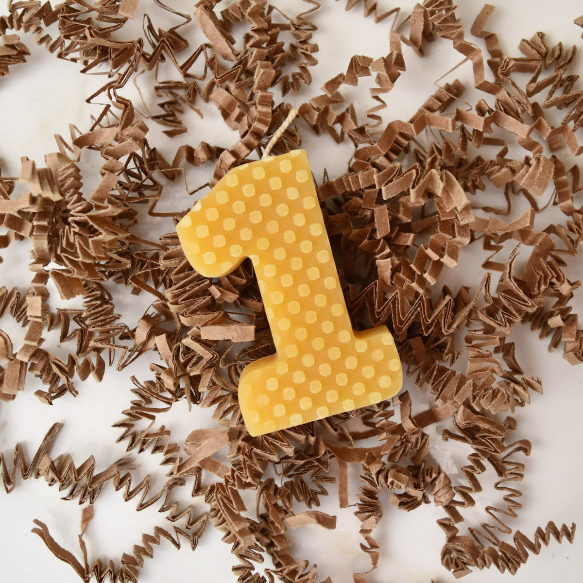 Yellow beeswax number one birthday candle