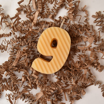 Yellow beeswax candle birthday number nine