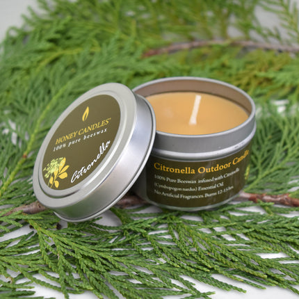 Citronella essential oil infused beeswax silver tin candle with forest background