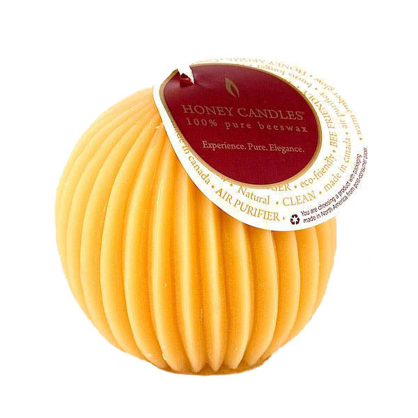 pretty natural colour fluted sphere candle