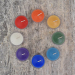 Rainbow beeswax tealight candles placed in a circle
